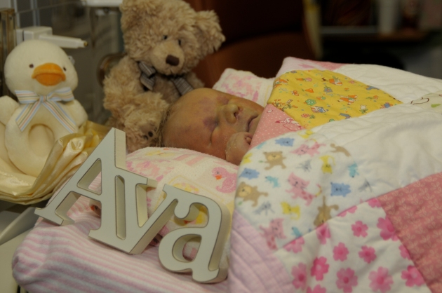 Ava with her toys