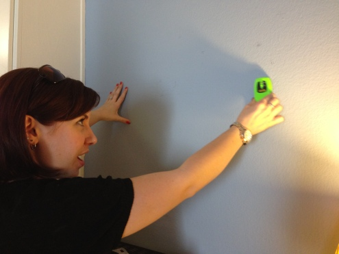 Bryce using her handy dandy STUD FINDER.